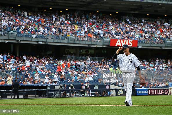 Masahiro Tanaka of the New York Yankees walks off the mound after being removed in the eighth inning against the Baltimore Orioles at Yankee Stadium...