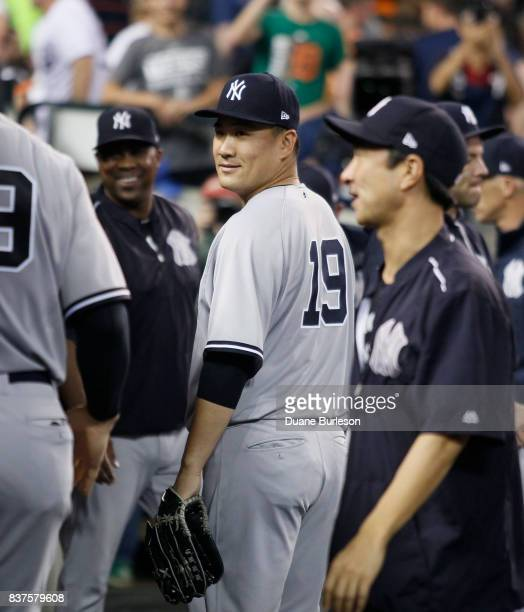 Masahiro Tanaka of the New York Yankees walks through the dugout after pitching against the Detroit Tigers during the seventh inning at Comerica Park...