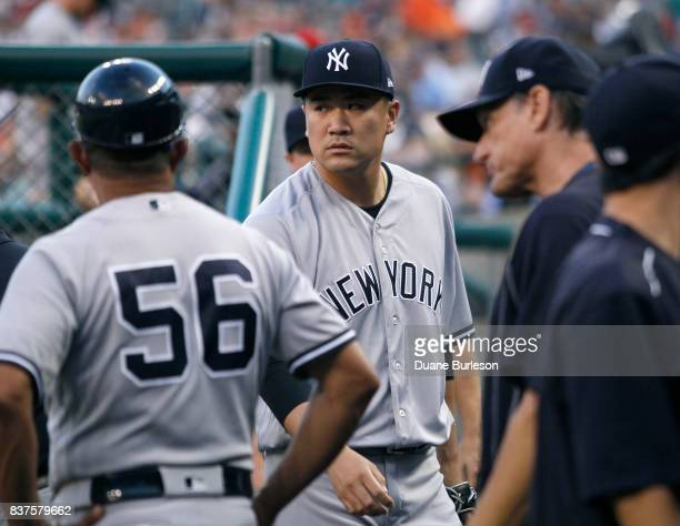 Masahiro Tanaka of the New York Yankees walks through the dugout after pitching against the Detroit Tigers during the second inning at Comerica Park...