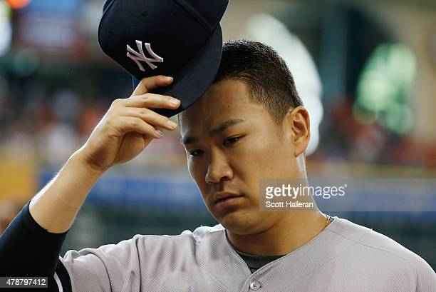 Masahiro Tanaka of the New York Yankees walks to the dugout before their game against the Houston Astros at Minute Maid Park on June 27 2015 in...