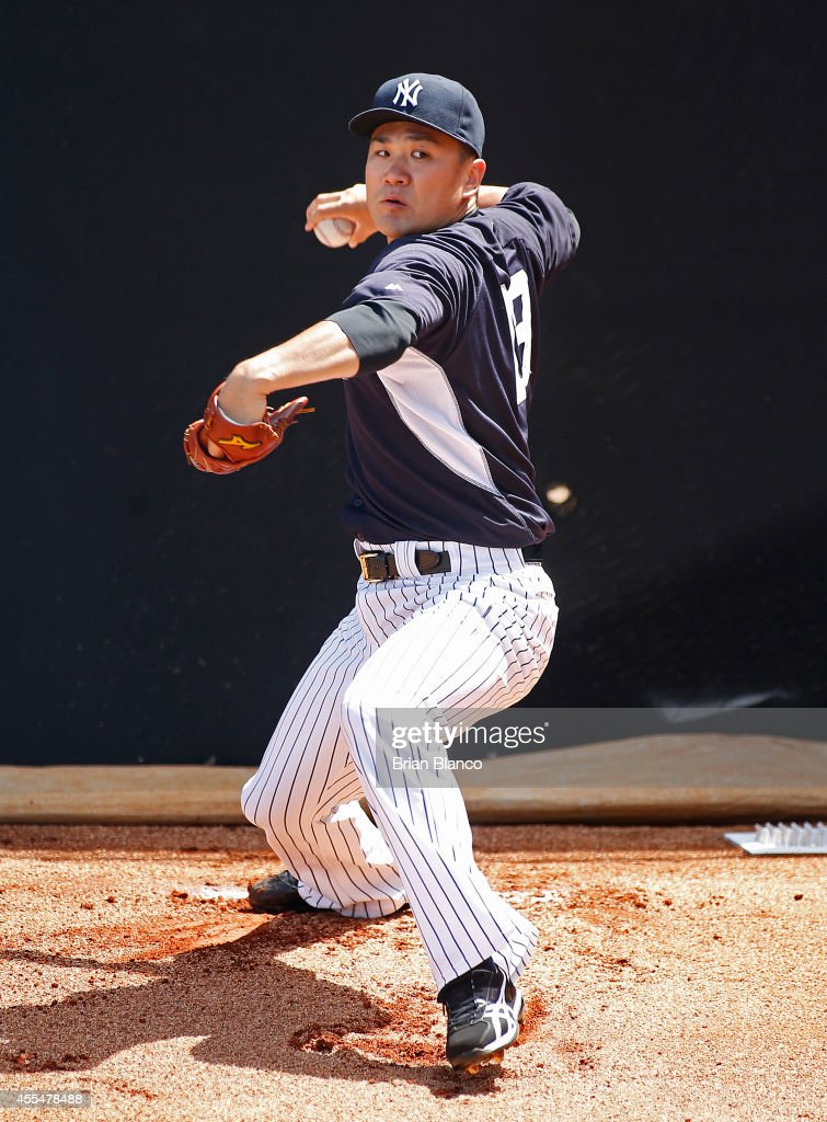 Masahiro Tanaka of the New York Yankees warms up in the bullpen before pitching in a simulated game on September 15 2014 at George M Steinbrenner...