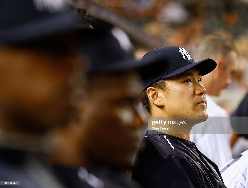 Masahiro Tanaka #19 of the New York Yankees watches from the dugout in the seventh inning against the Boston Red Sox during a MLB baseball game at Yankee Stadium on August 6, 2015 in the Bronx borough of New York City. The Yankees defeated the Red Sox 2-1.