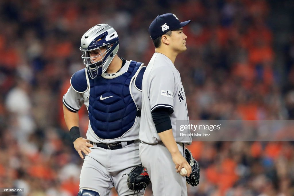 Masahiro Tanaka #19 talks to Gary Sanchez #24 of the New York Yankees after Sanchez was hit in the leg by a pitch in the third inning against the Houston Astros during game one of the American League Championship Series at Minute Maid Park on October 13, 2017 in Houston, Texas.