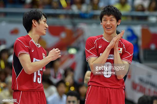 Masahiro Yanagida and Yuki Ishikawa talk during Time out in the match against Iran during the FIVB Men's Volleyball World Cup Japan 2015 at the Osaka...