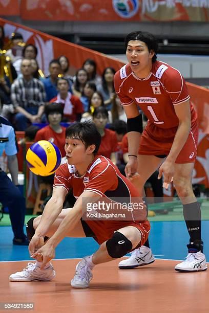 Masahiro Yanagida of Japan receives the ball during the Men's World Olympic Qualification game between Japan and Venezuela at Tokyo Metropolitan...