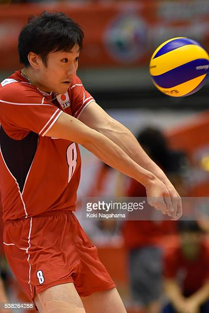 Masahiro Yanagida of Japan receives the ball during the Men's World Olympic Qualification game between France and Japan at Tokyo Metropolitan...