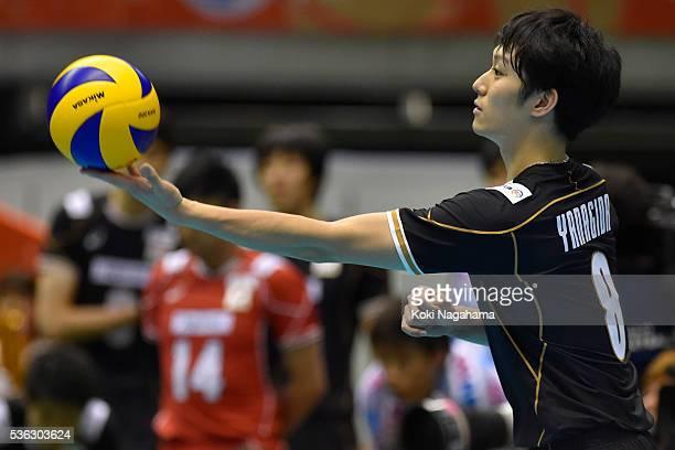 Masahiro Yanagida of Japan serves the ball during the Men's World Olympic Qualification game between Japan and Iran at Tokyo Metropolitan Gymnasium...