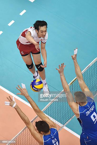 Masahiro Yanagida of Japan spikes in the match between Italy and Japan during the FIVB Men's Volleyball World Cup Japan 2015 at the Hiroshima Green...