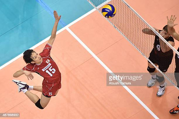 Masahiro Yanagida of Japan spikes in the match between Japan and Canada during the FIVB Men's Volleyball World Cup Japan 2015 at the Hiroshima Green...