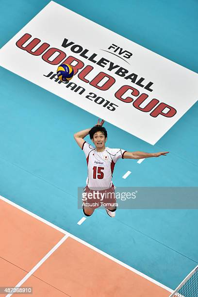 Masahiro Yanagida of Japan spikes in the match between USA and Japan during the FIVB Men's Volleyball World Cup Japan 2015 at the Hiroshima Green...