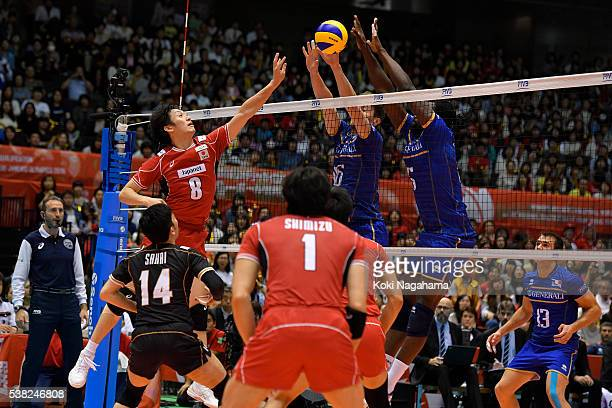 Masahiro Yanagida of Japan spikes the ball during the Men's World Olympic Qualification game between France and Japan at Tokyo Metropolitan Gymnasium...