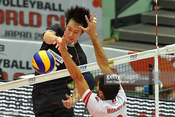 Masahiro Yanagida of Japan spikes the ball in the match against Tunisia during the FIVB Men's Volleyball World Cup Japan 2015 at the Osaka Municipal...