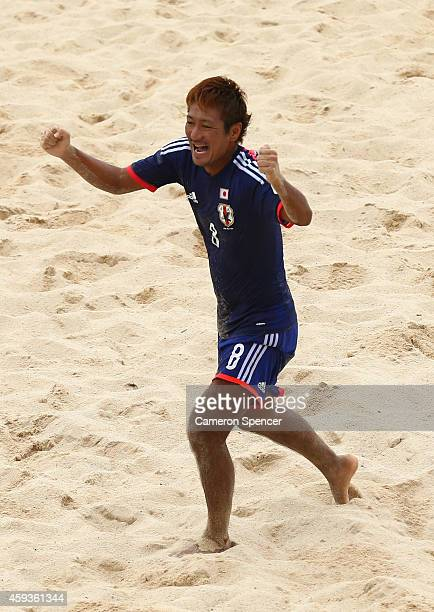 Masahito Toma of Japan celebrates scoring a goal during the Men's Beach Soccer gold medal match between Iran and Japan during the 2014 Asian Beach...