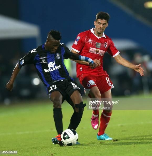 Masahudu Alahassan of Latina competes for the ball with Stefano Saballi of Bari during the Serie B playoff match between US Latina and AS Bari at...