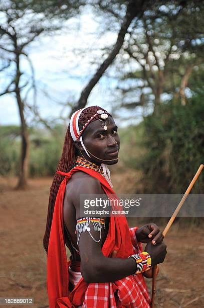 Masai outdoors in traditional clothing