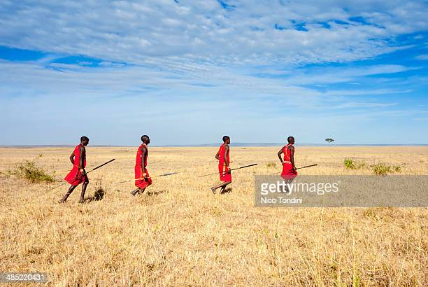 Masai running in the savannah, Kenya