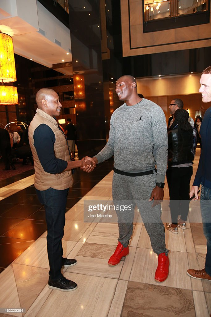 Masai Ujiri, General Manager chats with Bismack Biyombo of the Toronto Raptors as they arrives for the Basketball Without Boarders program on July 28, 2015 at the Hyatt Regency Hotel in Johannesburg, South Africa.