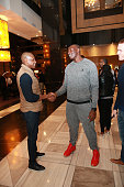Masai Ujiri General Manager chats with Bismack Biyombo of the Toronto Raptors as they arrives for the Basketball Without Boarders program on July 28...