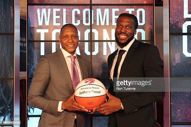 Masai Ujiri GM of the Toronto Raptors introduces DeMarre Carroll during a press conference on July 9 2015 at the Air Canada Centre in Toronto Ontario...