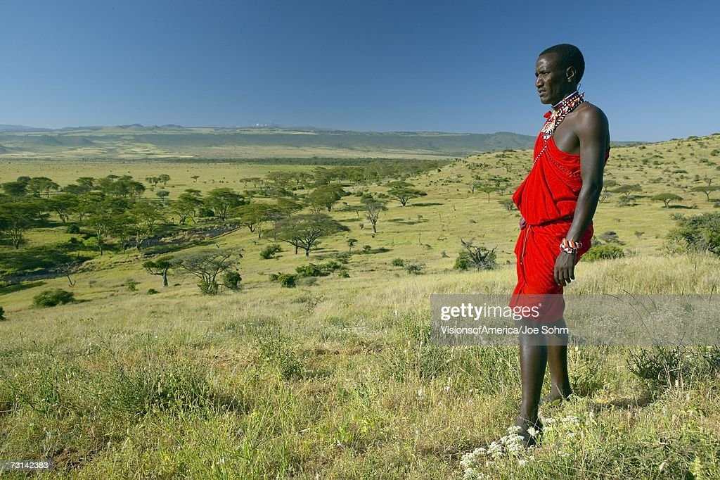 Masai Warrior in red surveying landscape of Lewa Conservancy, Kenya, Africa : Stock Photo