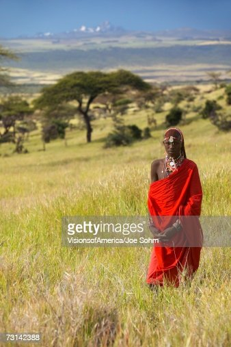 Masai Warrior in red surveying landscape of Lewa Conservancy, Kenya Africa : Stock Photo