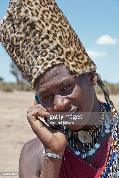 Masai warrior talking on smart phone