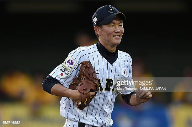 Masakai Oyokawa smiles after the top half of the first inning in the super round game between Japan and Venezuela during The 3rd WBSC U15 Baseball...