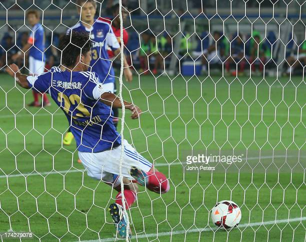 Masakazu Tashiro of Yokohama FMarinos scores an owngoal during the preseason friendly match between Yokohama FMarinos and Manchester United at Nissan...
