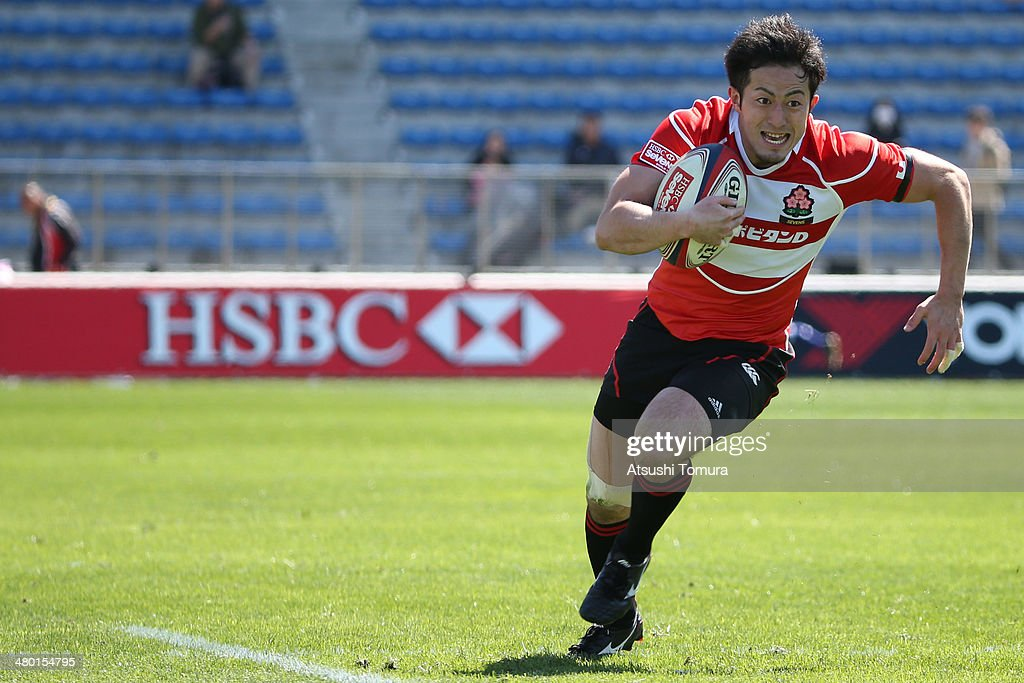 Masaki Watanabe #7 of Japan makes a break against Argentina during the Tokyo Sevens, the six round of the HSBC Sevens World Series at the Prince Chichibu Memorial Ground on March 22, 2014 in Tokyo, Japan.