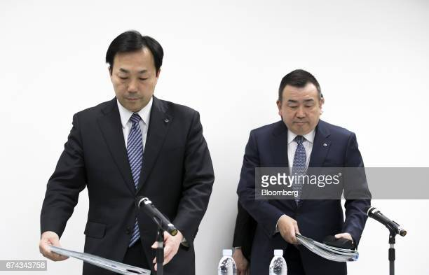 Masaki Yamauchi president of Yamato Holdings Co left and Yutaka Nagao president of Yamato Transport Co arrive for a news conference in Tokyo Japan on...