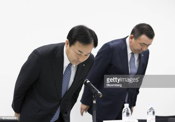 Masaki Yamauchi president of Yamato Holdings Co left and Yutaka Nagao president of Yamato Transport Co bow to the media as they arrive for a news...