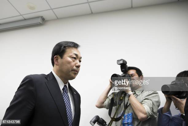 Masaki Yamauchi president of Yamato Holdings Co left leaves a news conference in Tokyo Japan on Friday April 28 2017 Yamato's shares gained the most...
