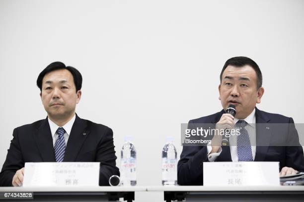 Masaki Yamauchi president of Yamato Holdings Co left listens as Yutaka Nagao president of Yamato Transport Co speaks during a news conference in...