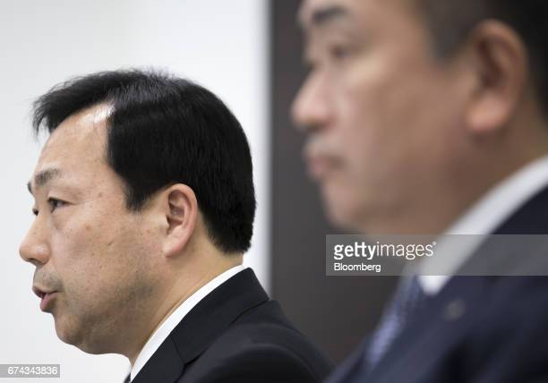 Masaki Yamauchi president of Yamato Holdings Co left speaks as Yutaka Nagao president of Yamato Transport Co looks on during a news conference in...