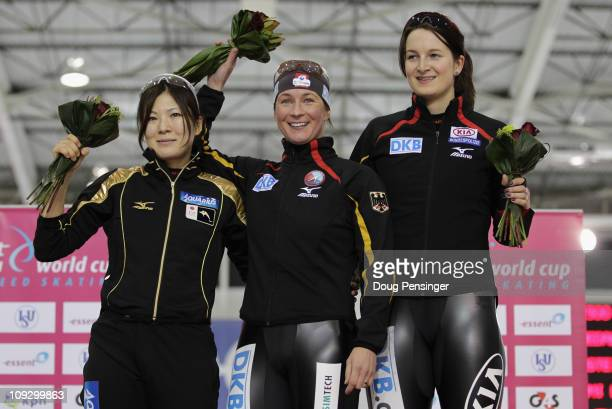 Masako Hozumi of Japan in second place Claudia Pechstein of Germany in first place and Jennifer Bay of Germany in third place take the podium for the...