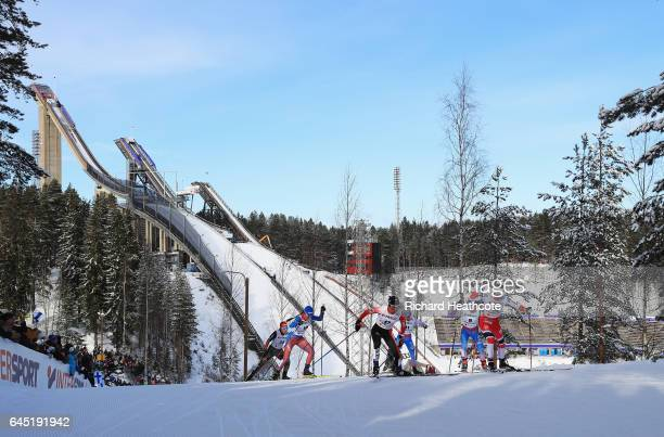 Masako Ishida of Japan and Astrid Uhrenholdt Jacobsen of Norway compete in the Women's Cross Country Skiathlon during the FIS Nordic World Ski...