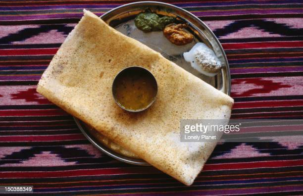 Masala dosa - A South Indian pancake made from a lentil flour and water batter and stuffed with mashed potato and spices