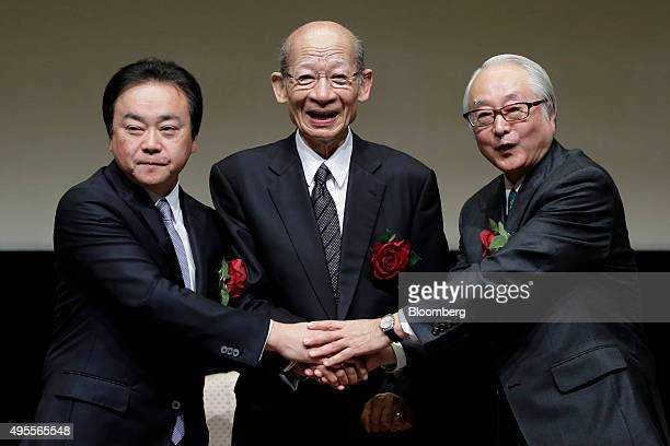 Masami Ishii president of Japan Post Insurance Co from left Taizo Nishimuro president of Japan Post Holdings Co and Masatsugu Nagato president of...
