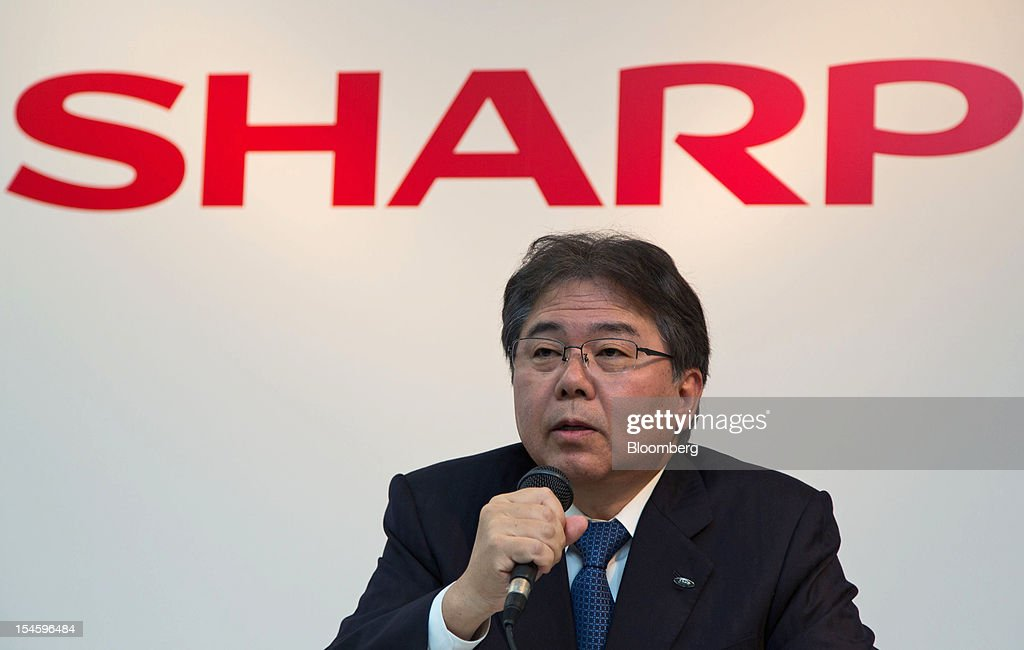 Masami Ohbatake, executive officer at Sharp Corp., speaks during a news conference at the launch of the company's new IGZO display in Tokyo, Japan, on Tuesday, Oct. 23, 2012. Sharp began making smartphone displays using a semiconductor technology known as IGZO this month at its plant in Tenri, central Japan, according to a company spokesman. Photographer: Noriyuki Aida/Bloomberg via Getty Images