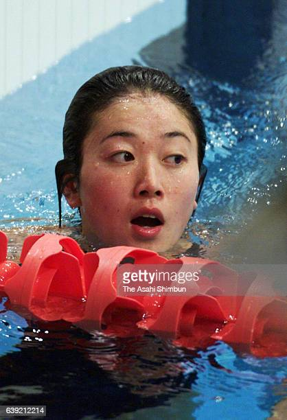 Masami Tanaka of Japan reacts after competing in the Women's 200m Breaststroke semi final during the Sydney Olympics at the Sydney International...