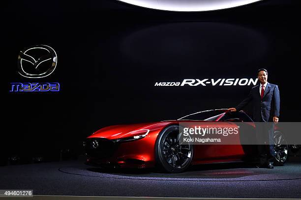 Masamichi Kogai Representative Director and President and CEO Mazda Motor Corporation poses for photographs during the Tokyo Motor Show 2015 at Tokyo...