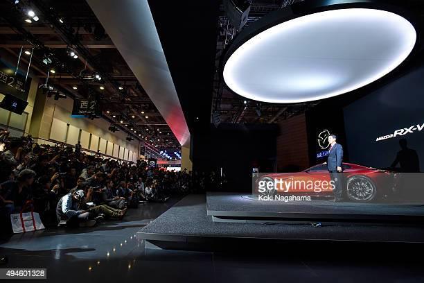 Masamichi Kogai Representative Director and President and CEO Mazda Motor Corporation poses for photographs during the Tokyo Motor Show 2015 at Tokyo...