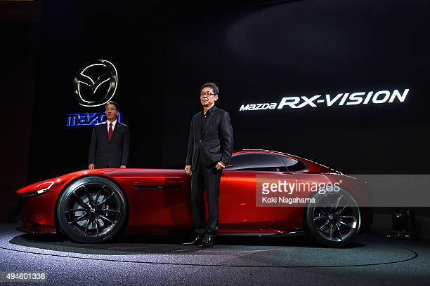 Masamichi Kogai Representative Director and President and CEO Mazda Motor Corporation and Ikuo Maeda Executive Officer Design Chief Mazda Motor...