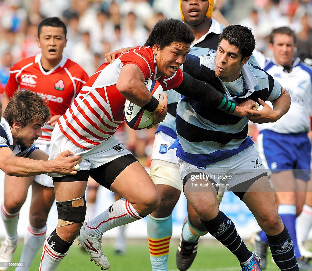 Masamichi Tatekawa of Japan XV runs with the ball during the match between Japan XV and French Barbarians at Prince Chichibu Stadium on June 24, 2012 in Tokyo, Japan.