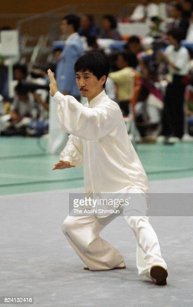 Masaru Matsuda of Japan competes in the Wushu Men's Taijiquan during the 12th Asian Games Hiroshima at Aki Ward Sports Center on October 12 1994 in...