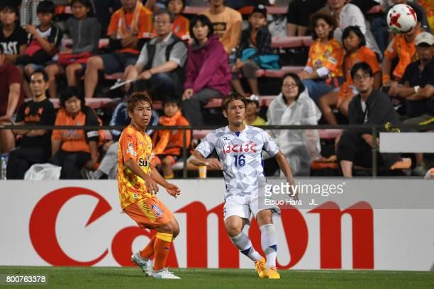 Masaru Matsuhashi of Ventforet Kofu and Shota Kaneko of Shimizu SPulse compete for the ball during the JLeague J1 match between Shimizu SPulse and...