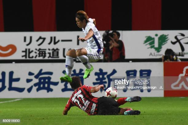 Masaru Matsuhashi of Ventforet Kofu is tackled by Hidetaka Kanazono of Consadole Sapporo during the JLeague J1 match between Consadole Sapporo and...