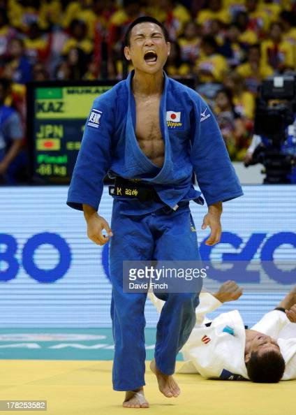 Masashi Ebinuma of Japan screams in celebration after throwing Azamat Mukanov of Kazakstan for ippon to win the u66kgs gold medal during day 2 of the...
