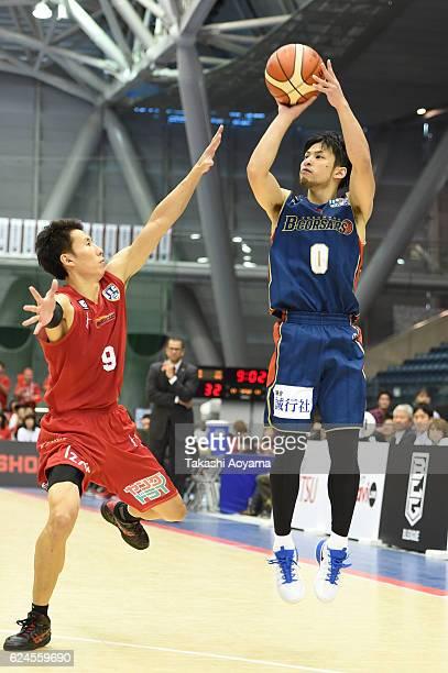 Masashi Hosoya of the Yokohama BCorsairs shoots over Takeshi Mito of the Toyama Grouses during the B League match between Yokohama BCorsairs v Toyama...