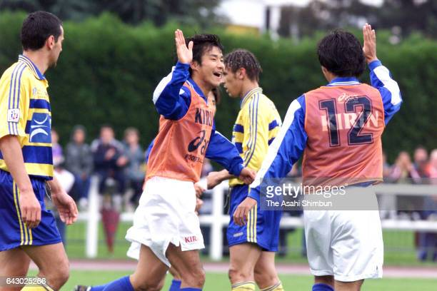 Masashi Nakayama of Japan celebrates scoring a goal with his team mate Shoji Jo during a practice match on June 7 1998 in AixlesBains France